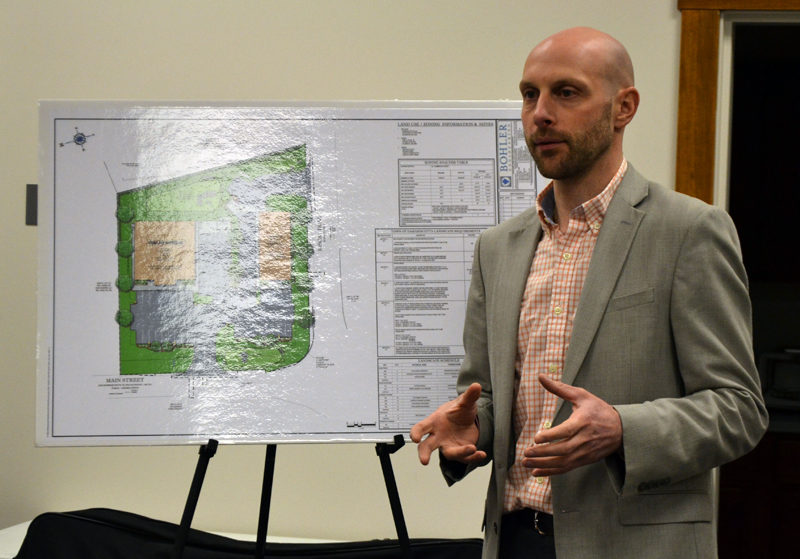 Austin Turner, a civil engineer with Bohler Engineering, discusses Damariscotta DG LLC's application to build a Dollar General store and a Sherwin-Williams store at the intersection of Main Street and Biscay Road during the Damariscotta Planning Board's Monday, March 6 meeting. (Maia Zewert photo)