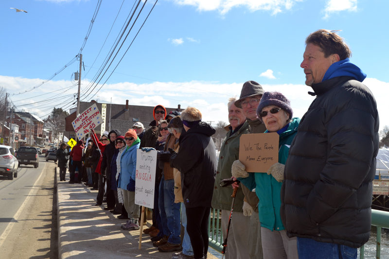 People stand on the Damariscotta-Newcastle bridge during a rally in support of constitutional rights Sunday, March 19. (Maia Zewert photo)