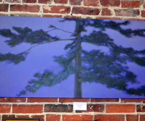 "Beverly Walker's large oil painting titled ""Midnight"" is one of numerous landscape paintings on display at the Damariscotta River Grill as part of the Pemaquid Group of Artists' show running through Tuesday, March 21. (Christine LaPado-Breglia photo)"