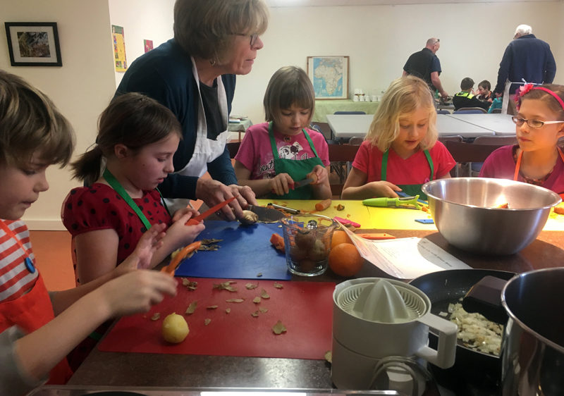 Students receive instruction from Jean Kerrigan, the general manager of Damariscotta River Grill.