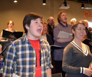 "Foreground from left: Roosevelt Bishop, who plays Bert in Lincoln County Community Theater's upcoming production of ""Mary Poppins,"" and Victoria Hamilton, who is in the title role, sing at a run-through of the musical on Sunday, March 12. (Christine LaPado-Breglia photo)"