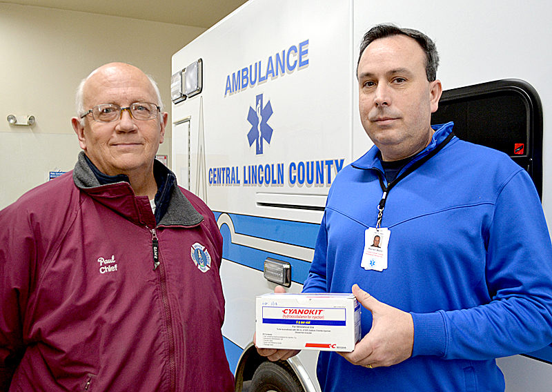 Bristol Fire Chief Paul Leeman Jr. (left) and Central Lincoln County Ambulance Service Chief Warren Waltz. Waltz holds a box of Cyanokit, a cyanide antidote. All five of the service's ambulances now carry Cyanokit thanks to a collaboration between the service and area fire departments. (Maia Zewert photo)