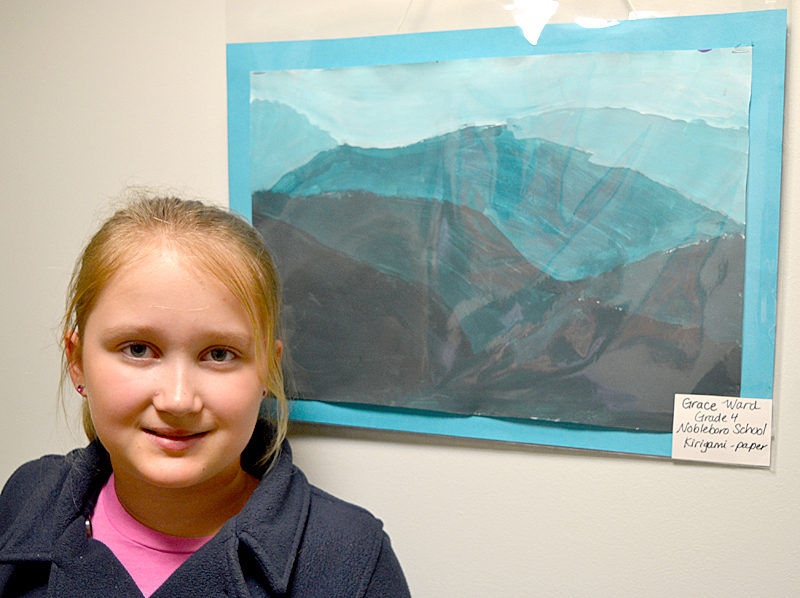 "Nobleboro Central School fourth-grader Grace Ward poses with her painted ""kirigami"" piece on Wednesday, March 8 at The Lincoln Home in Newcastle. (Christine LaPado-Breglia photo)"