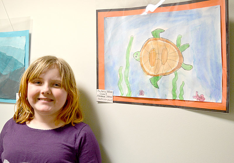 Nine-year-old MacKenzie Wilcox, who is in the third grade at Nobleboro Central School, poses with her watercolor painting of a sea turtle. (Christine LaPado-Breglia photo)