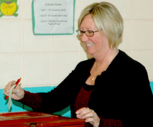 Nobleboro Town Clerk Susan Pinnetti-Isabel casts her ballot on the education budget during the annual town meeting at Nobleboro Central School on Saturday, March 18. (Alexander Violo photo)