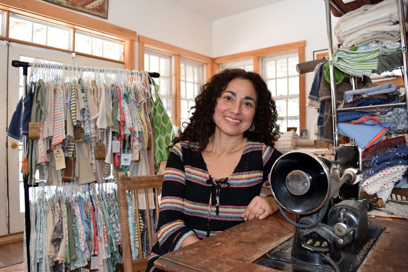 Vero Poblete-Howell sits at an antique sewing machine in the Baobab Organics studio in Waldoboro on Feb. 10. Poblete-Howell, originally of Santiago, Chile, became a U.S. citizen Friday, March 3. (J.W. Oliver photo)