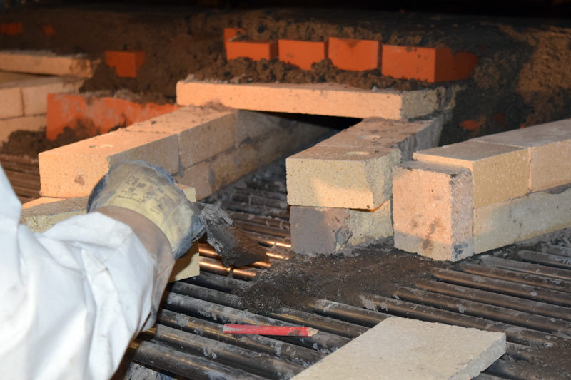 Norbert Creutzer works on the masonry in the new oven at Borealis Breads in Waldoboro. (J.W. Oliver photo)