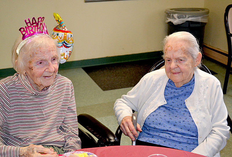 Lillie Weissenberger (left) celebrates her 100th birthday Monday, March 27 at the Country Manor Nursing Home in Whitefield with her sister, Beverly Travers, by her side. (Abigail Adams photo)
