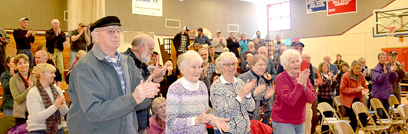 Whitefield residents give David and Barbara Hayden a standing ovation during the annual town meeting Saturday, March 18. The Whitefield Board of Selectmen honored the Haydens with the Spirit of America Award for their volunteerism. (Maia Zewert photo)