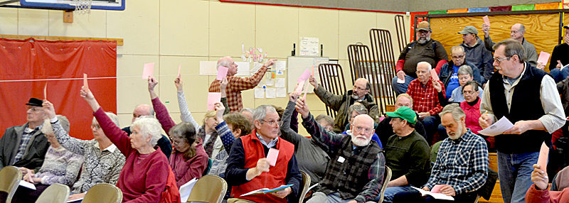 Whitefield Selectman Lester Sheaffer (far right) counts votes during the annual town meeting at Whitefield Elementary School on Saturday, March 18. (Maia Zewert photo)