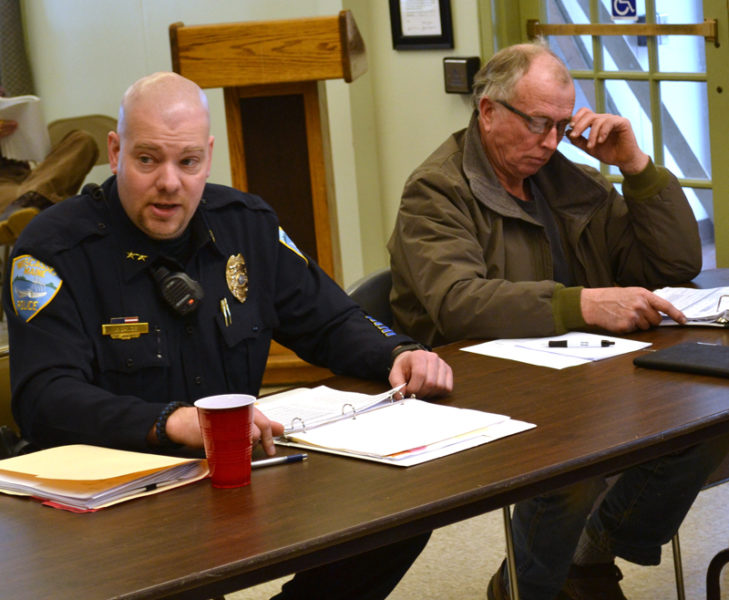 Wiscasset Police Chief Jeffrey Lange presents the department's 2017-2018 budget to selectmen and the budget committee Saturday, Feb. 25, as budget committee member Bryan Buck reviews the proposal. (Abigail Adams photo)
