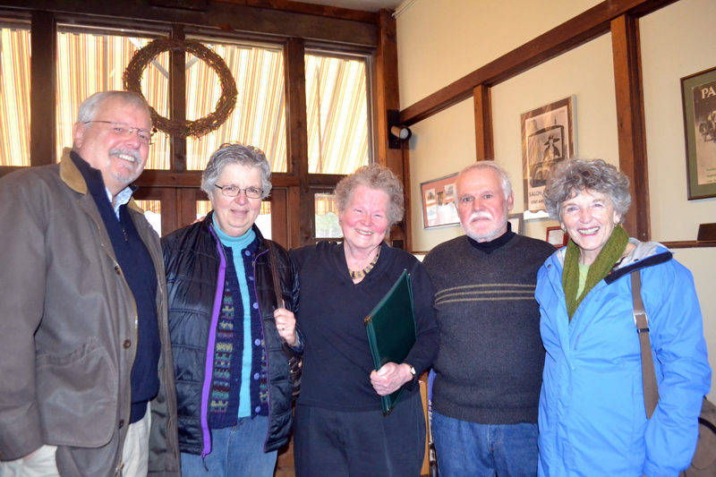 Le Garage owner Cheryl Rust (center) prepares to seat four friends at the restaurant. From left: David Sears, Judy Sears, Rust, Tom Rankin, and Susan Rankin. Rust will receive the Bill Zoidis Lifetime Achievement Award from the Maine Restaurant Association on March 28. (Charlotte Boynton photo)