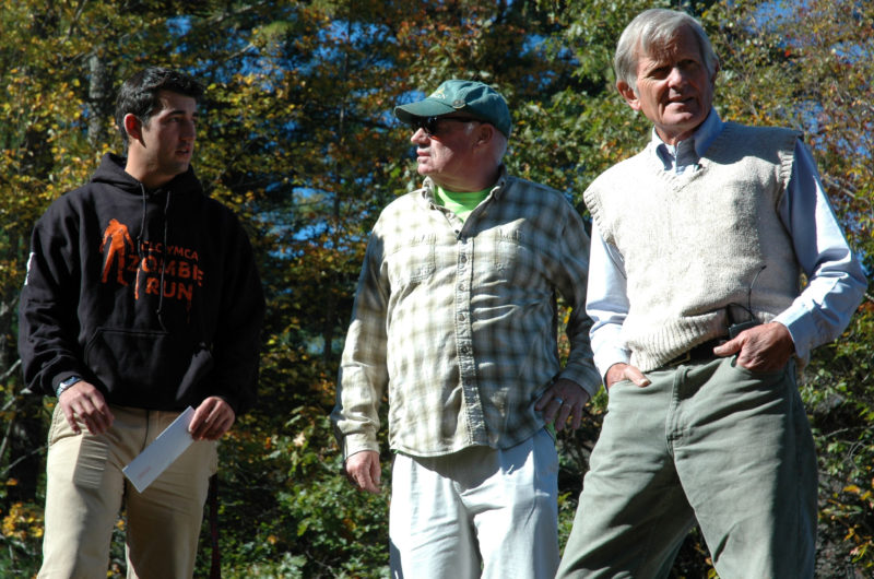 """Kit Hayden (right) surveys the Zombie Run course at the CLC YMCA in Damariscotta during the filming of a """"Wuzzup"""" episode Oct. 9, 2013. CLC YMCA Program Director Joe Clark (left) was explaining the Zombie Run to Hayden and co-host Bobby Whear. (J.W. Oliver photo, LCN file)"""