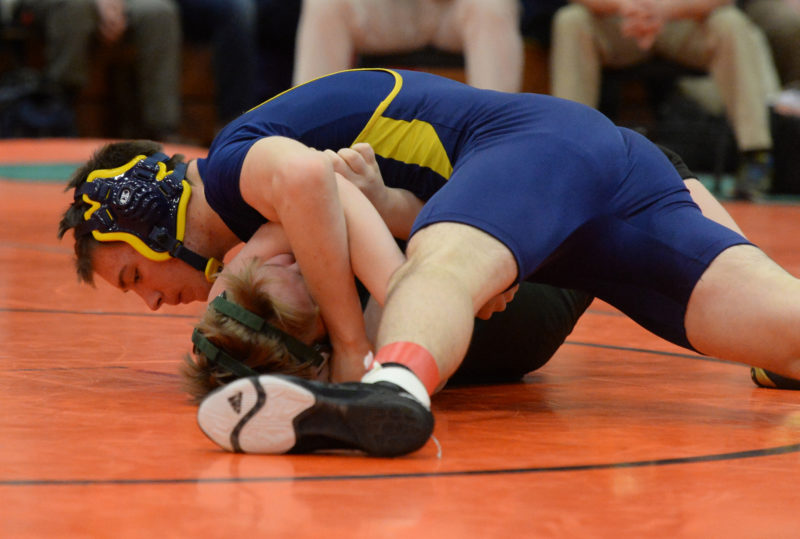 Tyler Cox rolls an Bristol Leahy of Oak Hill for a quick pin at the Pine Tree State Championships. Cox placed second at 155 pounds. (Paula Roberts photo)