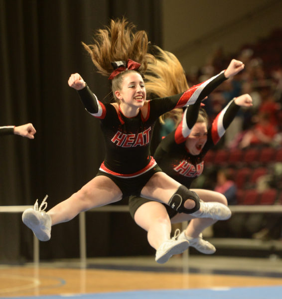 Wiscasset cheerleaders leap into the air during their performance in Bangor on Sunday. (Paula Roberts photo)