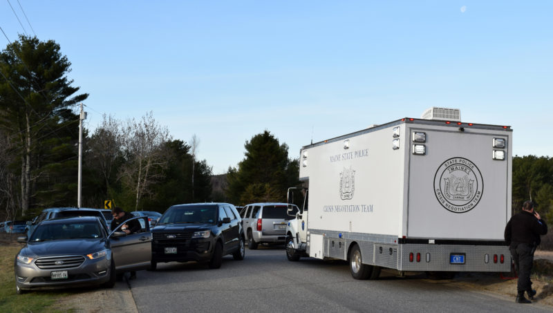 Lincoln County Sheriff's Office and Maine State Police vehicles block Pension Ridge Road in Boothbay the morning of Saturday, April 15. (J.W. Oliver photo)