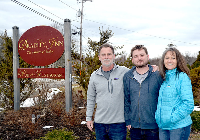 From left: Tony, Ross, and Laura Moskwa are the new owners of The Bradley Inn. The Moskwas, formerly of Auburn, Calif., closed on the inn Thursday, March 30. (Maia Zewert photo)