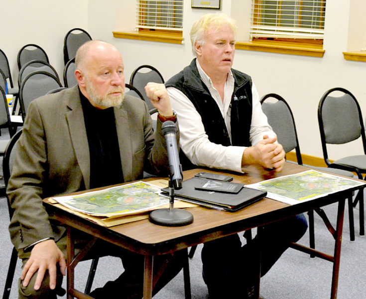 From left: Andrew Sturgeon, director of Maine operations for Hoyle, Tanner & Associates Inc., and Commercial Properties Inc. CEO Daniel Catlin discuss their plans for a retail development at 435 Main St. in Damariscotta during the Damariscotta Planning Board meeting Monday, April 3. (Maia Zewert photo)