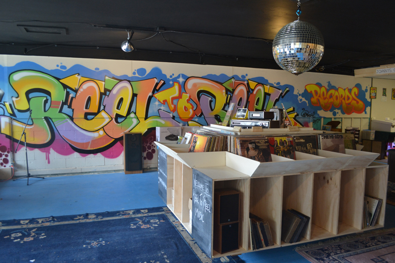 Portland artist Mike Rich designed and painted the mural at Reel to Reel Music. (Maia Zewert photo)