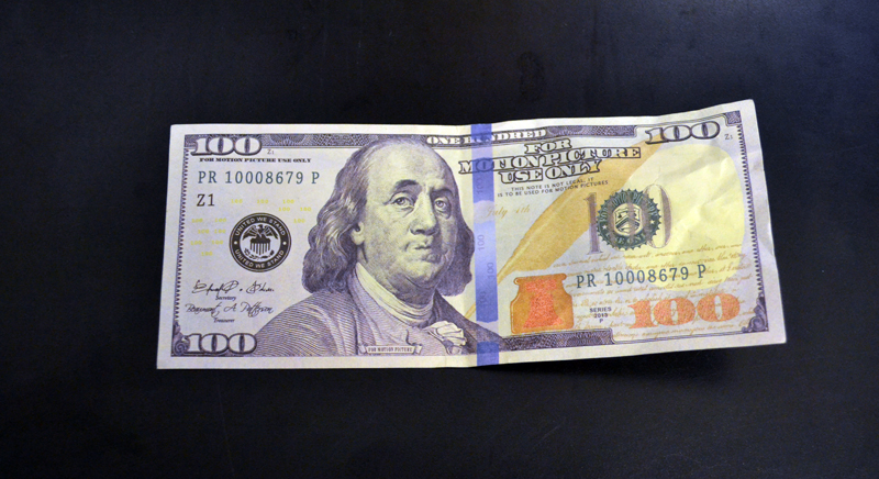 The Damariscotta Police Department is warning area businesses and residents to be on the lookout for fake $100 bills like this movie prop, recently passed at a local business. (Maia Zewert photo)