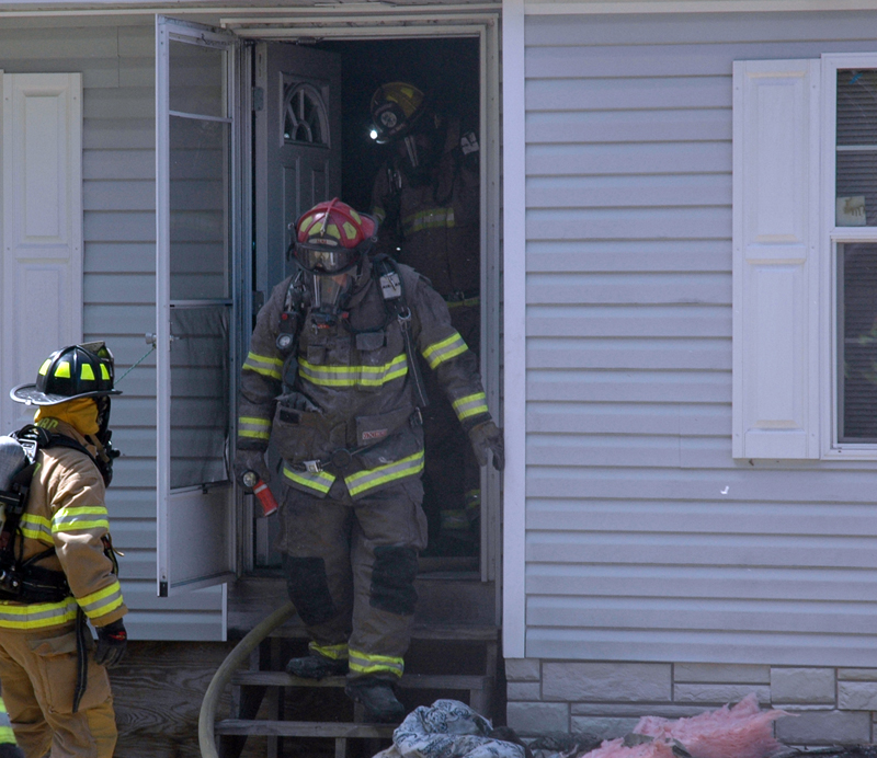 Firefighters exit a home at 1351 South Clary Road in Jefferson after preventing a fire in the bathroom from spreading to the rest of the home. (Alexander Violo photo)