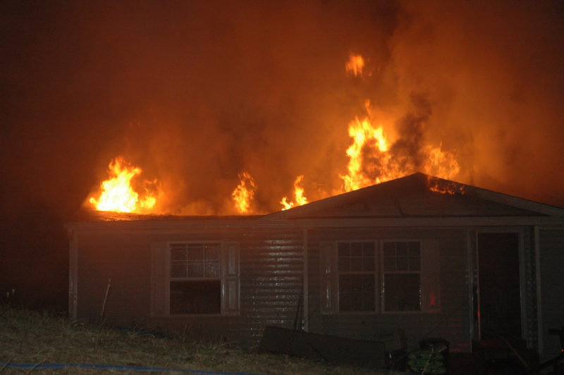 Flames shoot through the roof at 1351 South Clary Road during the evening of Monday, April 17. (Alexander Violo photo)
