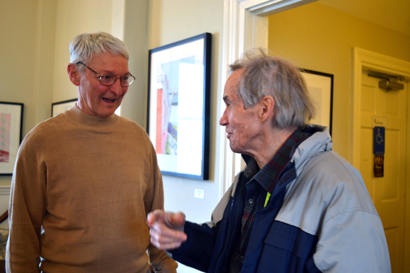 Damariscotta watercolorist Paul Sherman (left) greets one of his fans at the April 21 opening reception for his art show at Savory Maine. (Christine LaPado-Breglia photo)