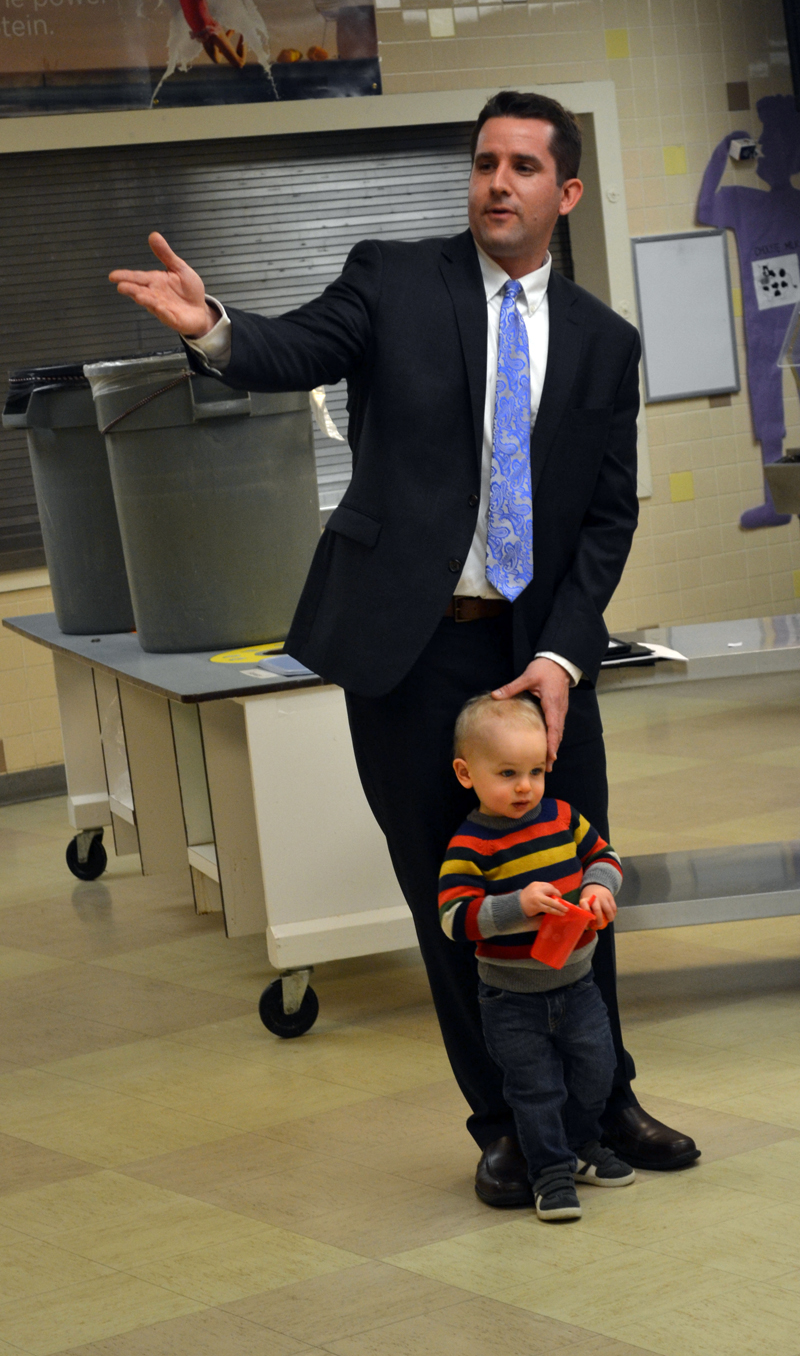 Jonathan Liberman, with his son Benjamin, introduces himself to member of the Knox, Lincoln, Sagadahoc, and Waldo County Republican committees during a caucus at Wiscasset Elementary School on Monday, April 10. The four county committees met to recommend candidates to replace District Attorney Geoffrey Rushlau. (Abigail Adams photo)