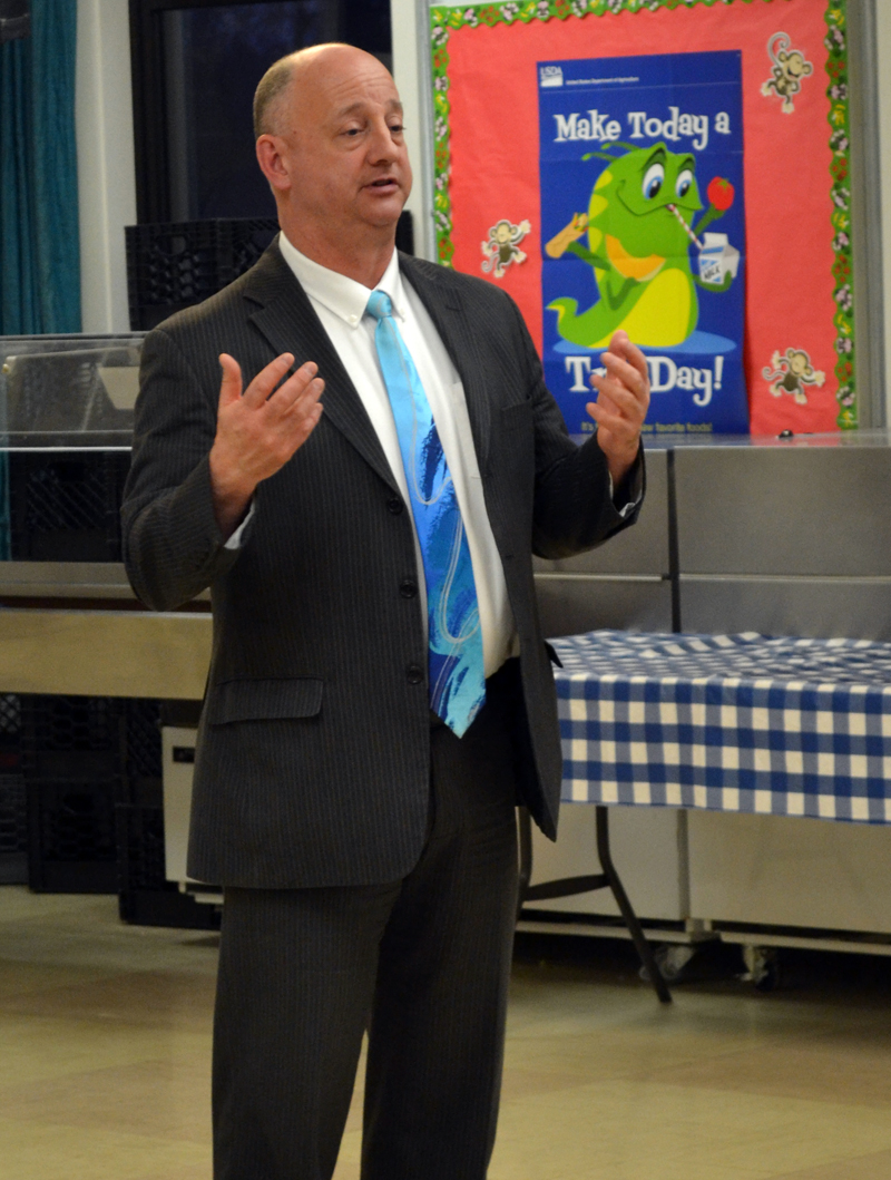 Paul Cavanaugh talks about his interest in serving as district attorney for Maine Prosecutorial District 6 during a caucus at Wiscasset Elementary School on Monday, April 10. (Abigail Adams photo)