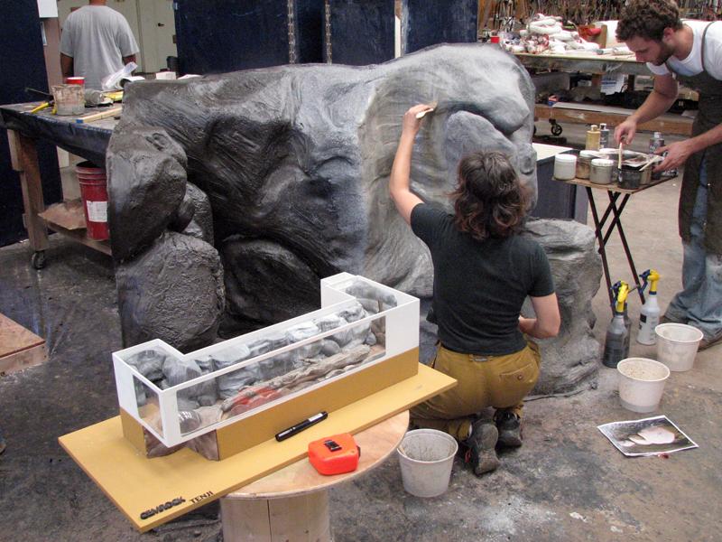 "Tenji sculpters carve ""rocks"" from foam for the Riverbed Aquarium in L.L. Bean's flagship store in Freeport. (Photo courtesy Edward Seidel)"