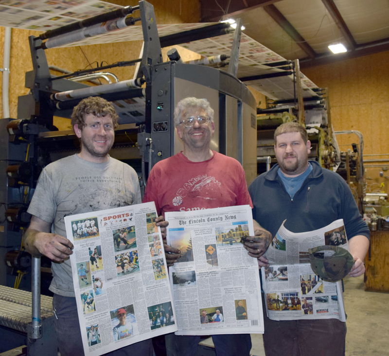 After working all night to complete the installation of two new color units, The Lincoln County News Publisher Chris Roberts (center) and Associate Publishers John Roberts (left) and Allan Roberts hold copies of the March 30 edition. (J.W. Oliver photo)
