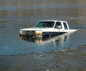 A truck went into the water, attempting to pick up a boat, at Pine Street Landing in Waldoboro on the afternoon of Sunday, April 9. (Alexander Violo photo)