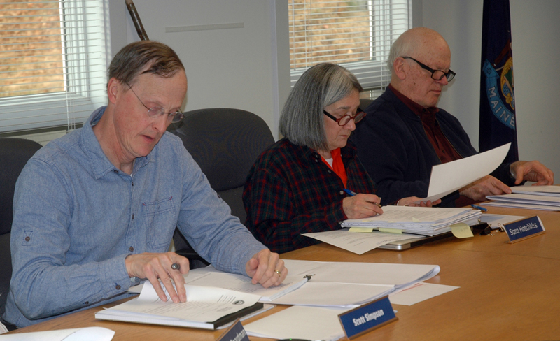 From left: Waldoboro Planning Board members Scott Simpson, Sara Hotchkiss, and Ted Wooster review documents for the First Baptist Church of Waldoboro's sanctuary project. (Alexander Violo photo)