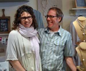 The new owners of In the Clover, Casey and Jay McNamara, prepare to open the store on Main Street in Wiscasset on Monday, April 24. (Abigail Adams photo)