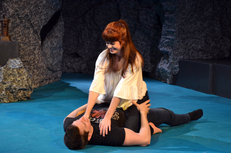 """Nashville-based actor Gina D'Arco, as Eurydice, sits astride Austin Olive, who plays Orpheus, in a scene from Heartwood Regional Theater Company's """"Eurydice"""" at an April 20 run-through of the play at the Parker B. Poe Theater. (Christine LaPado-Breglia photo)"""