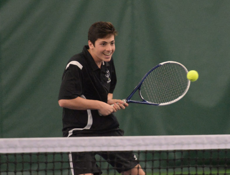 Nicos Campos is all smiles as he returns his fourth straight shot at the net. (Paula Roberts photo)