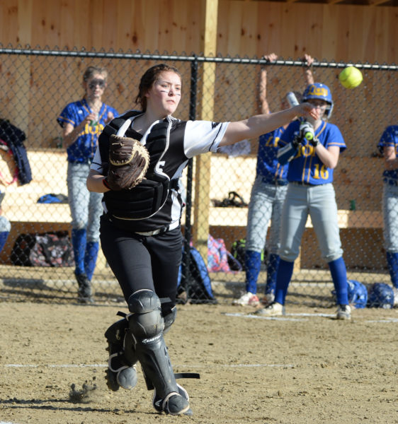 Lincoln Academy catcher Christine Hilton field a bunt and rifles a throw to first. )Paula Roberts photo)