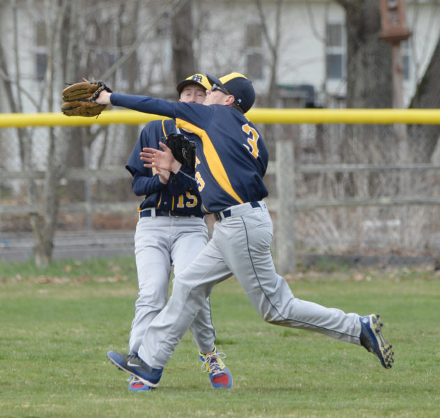 Patrick White makes the running catch in a near collision with center fielder Wyatt Post. (Paula Roberts photo)