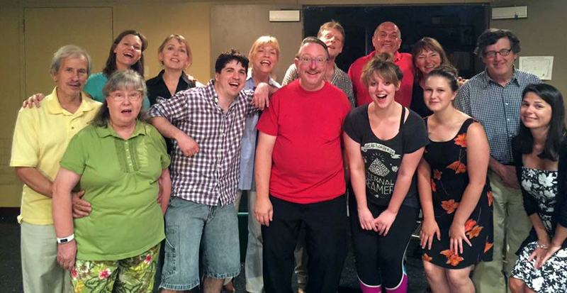 "Cast and crew photo from River Company's 2016 production of ""Love/Sick""  first row (l to r) Beth Rowe, Tyson Bailey, Mitchell Wellman Lainey Catalino, Thalia Eddyblouin, Mallory Adams second row (l to r) Mike Rowe, Allison Eddyblouin, Christine Anderson, Judy McQuillen, Bill Burleson, Tom Handel, Andrea Handel, Stephen Wallace"
