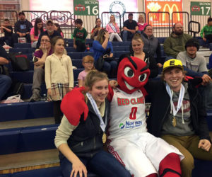 Lincoln Academy students Brie Wajer (front left) and Evan Eckel (right), CLC Y youth board members for 2015-2017, celebrate at the March 26 Maine Red Claws youth-volunteer recognition game, where they were each presented with a service certificate and a Maine Volunteer Service medallion.