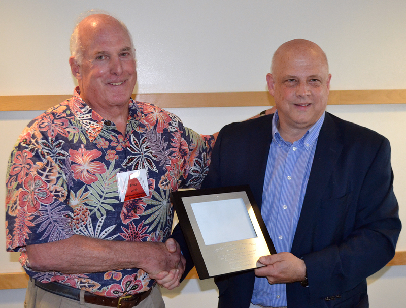 Bruce Lutsk (left) receives the Individual Community Service Award from outgoing Damariscotta Region Chamber of Commerce board member John Bottero during the chamber's annual meeting Thursday, May 18 in the Lincoln Academy Alumni Dining Commons. (Maia Zewert photo)