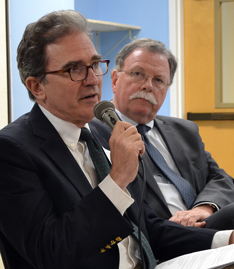 Greg Kesich, editorial page editor for the Portland Press Herald, answers a question while WCSH 6 reporter Don Carrigan looks on during a forum about fake news Wednesday, May 24. (Maia Zewert photo)