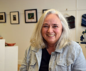 Pemaquid artist Alice de Mauriac sits in the West Gallery of River Arts in Damariscotta. (Christine LaPado-Breglia photo)
