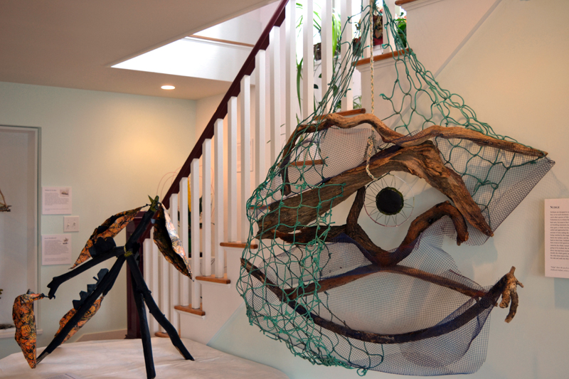 "From left: Eco-artist Marnie Sinclair's large pieces ""Monarch Butterflies"" and ""Nudge"" grace the area near the stairs at Deb Poor's house-turned-gallery in Newcastle. (Christine LaPado-Breglia photo)"