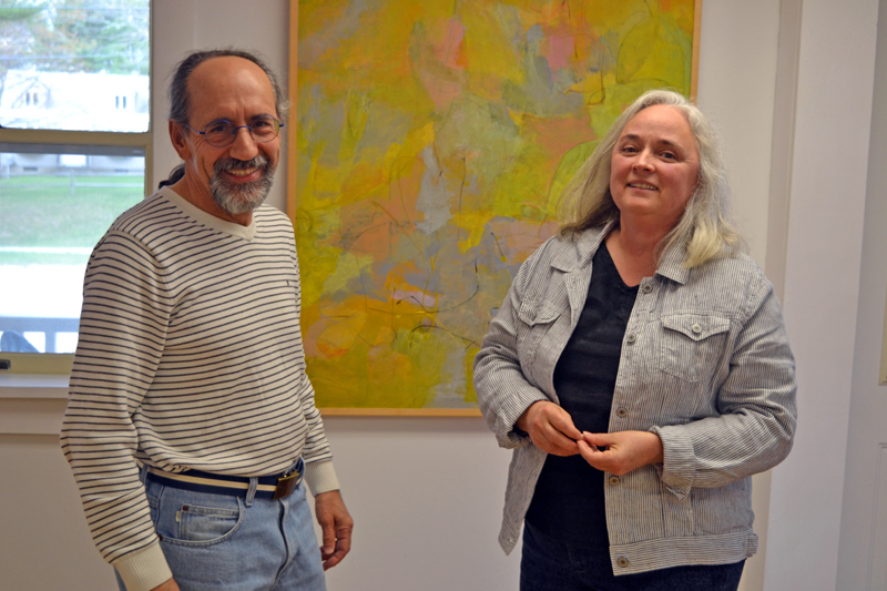 Alice de Mauriac stands before one of her paintings with her husband, Julio Sanchez-Banos, in the main gallery of River Arts. (Christine LaPado-Breglia photo)
