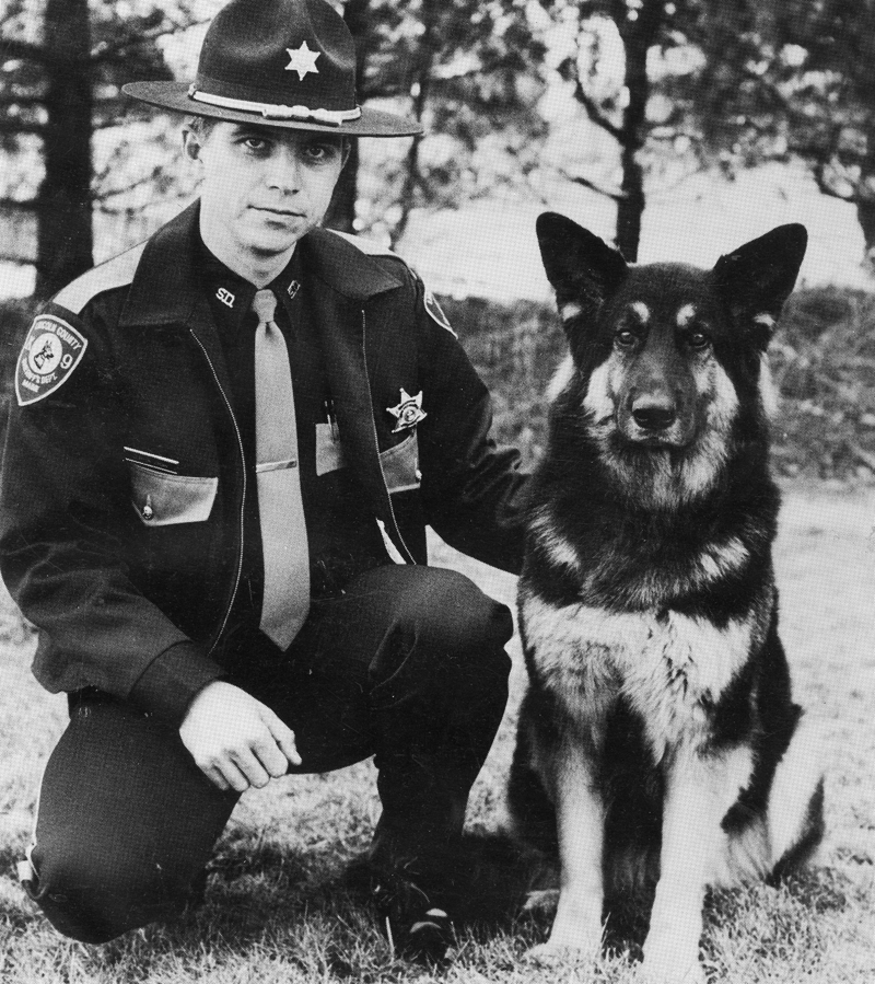 Lincoln County Sheriff's Deputy Clayton Jordan with Heidi, his K-9 partner through the late 1980s and early 1990s. (Photo courtesy Clayton Jordan)