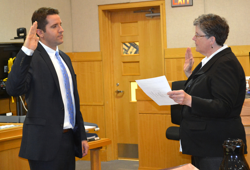 Sagadahoc County Clerk of Courts Anita Alexander administers the oath of office to District Attorney Jonathan Liberman at West Bath District Court on Friday, May 19. (Abigail Adams photo)