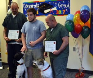 First Canines Graduate from Jail's New Dog Obedience Program