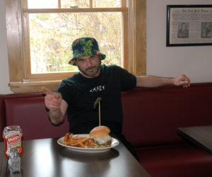 Mario Panagos with one of his burger creations at the Burger Bar in Waldoboro. (Alexander Violo photo)