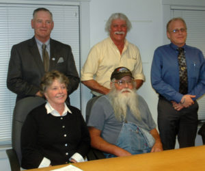 The five candidates for two seats on the Waldoboro Board of Selectmen. Standing from left: Clinton Collamore, Seth Hall, and Jeremey Miller. Sitting from left: Jann Minzy and Melvin Williams. (Alexander Violo photo)